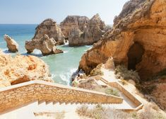 Rocky cliff seascape with steps to beach in Lagos, Algarve, Portugal. Visit Portugal, Spain And Portugal, Portugal Travel, Portugal Trip, Winter Beach, Beach Holiday, Summer Beach, Portugal Country, Ria Formosa