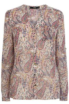 This gorgeous paisley shirt features a multicoloured print across the sheer chiffon fabric. The piece features an open v neckline and metallic button fastenings on the front. The piece is finished with pintuck sleeves that you can roll up or down for a versatile finish.