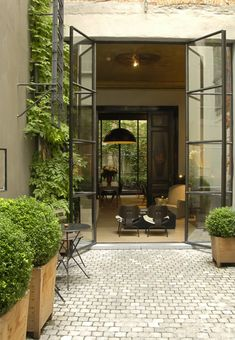 more steel french doors leading to a patio/courtyard Outdoor Rooms, Outdoor Living, Indoor Outdoor, Outdoor Decor, Exterior Design, Interior And Exterior, Exterior Doors, Modern Interior, Craftsman Exterior