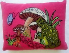 New pillow made from a vintage needlepoint of a frog and mushroom