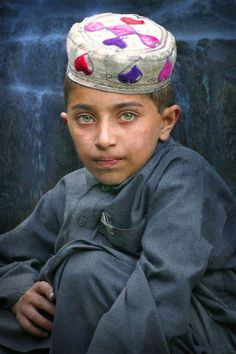 Green eyes, a pout on the lips - he might just grow up to be a model in Peshawar