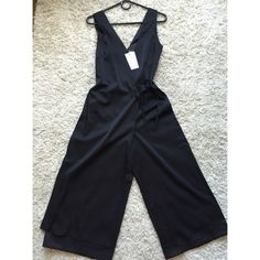 New (w/ tags) ASOS wrap front jumpsuit Super cute ASOS culotte jumpsuit with wrap front detail. Black, soft touch material, invisible zipper in back. Bought and tried it on and was too lazy to return it. ASOS Other
