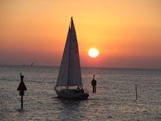Sailboat at sunset off Colington Island