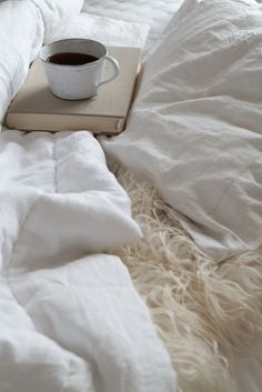 coffee in bed // good book // reading in bed // white sheets // soft bed // sherpa // sheepskin // cozy bed // fall inspiration // autumn leaves // cozy and warm // september // october // november