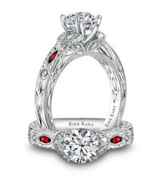 Kirk Kara Dahlia Engagement Ring Featuring 0.13 Carats Round White Diamonds and 0.15 Carats Marquise Cut Rubies in 18kt White Gold with Hand Engraved Details.