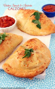 Pizza dough wraps around a tasty filling of chicken, artichokes, spinach, ricotta and mozzarella cheese in these personal-sized calzones or pizza pockets.