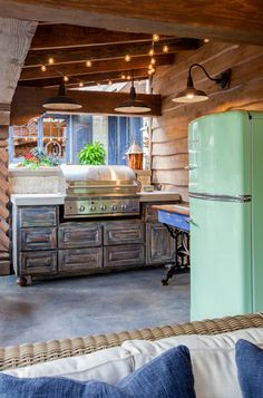 With summer in full swing check out this Jadite Green Big Chill Retro Refrigerator used in an Outdoor BBQ area. The perfect accessory for every grill master out there as we put together our best recipes for the few weekends we have left. Retro Refrigerator, Retro Fridge, Smeg Fridge, Rustic Patio, Rustic Outdoor, Outdoor Decor, Outdoor Rooms, Outdoor Living, Outdoor Kitchens