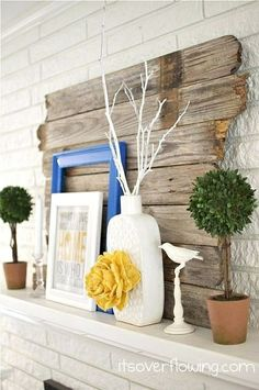 Reclaimed wood adds a great pop to any modern mantle.