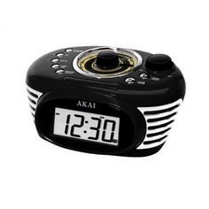 Akai Retro Alarm Clock Radio-Black. * Autoset* Manual DST* Time Zone Selection* FM Analogue Radio* Sleep Timer and Nap Timer* Single Alarm* 3 Mode jAlarm Setting (Everyday/ Date of Week/ Weekend)* Wake to Buzz or Radio* Display Feature Selection: 12/24hr. Month / Date* Battery Low Indicator* Line-in Function* LCD Display with Backlight and Dimmer* Extendable Antenna* Snooze function