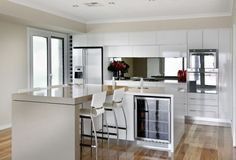 Similar floorboards with white kitchen.