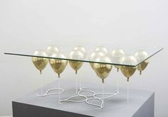 """""""British designer Christopher Duffy has created the UP Coffee Table…the UP coffee table is a playful trompe l'oeil, giving the impression that a piece of glass is being suspended by small balloons."""" (via The UP Coffee Table by Christopher Duffy Floating Balloons, Small Balloons, Gold Balloons, Floating Table, Helium Balloons, Coffee Table Design, Glass Top Coffee Table, Coffe Table, Glass Tables"""
