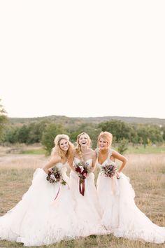 fluffy wedding gowns // photo by Mint Photography http://ruffledblog.com/antique-modern-wedding-ideas #weddingdresses #bridalfashion