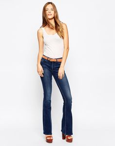 "Jeans by MiH Jeans Cotton stretch denim Button closure Regular rise Functioning pockets Skinny cut to the thigh Flared fit - cut with a straight leg that flares at the ankle Machine wash 98% Cotton, 2% Elastane Our model wears a UK 8/EU 36/US 4 and is 178cm/5'10"" tall"