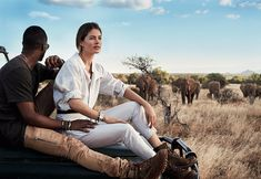 """My husband, Sunnery [James], is a city boy who doesn't like bugs, let alone a herd of elephants,"" says Kroes, one of the world's top supermodels, here with James at Samburu National Reserve in Kenya. ""Sitting on the hood of this car, I could feel his heart beating—and it wasn't for me."" Isabel Marant jumpsuit. Melissa Joy Manning earrings. CVC Stones necklace. Jutta Neumann New York belt. Scotch & Soda bracelet. 1-100 thick cuff. Melissa Joy Manning thin cuff. The Frye Company boots. On…"