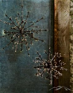 Lit Branch Snowflake. Light up the holidays with our delicate limbed snowflakes. Tiny white bulbs at the end of floral-tape wrapped wires illuminate when plugged in for a beautiful, ethereal glow. Rustic Christmas Decorations. Country Christmas. Natural Christmas. Mountain Christmas.