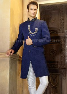 This stunning royal blue indo western in amazing soft Jute self pattern fabric is beautifully crafted with handwork. The attractive stone buttons and velevt pocket square makes it a royal wear for your special occasion. It is paired with the matchin Indian Wedding Wear, Pakistani Wedding Dresses, Indian Wear, Groom Wedding Dress, Wedding Suits, Indian Groom Dress, Mens Sherwani, Western Suits, Royal Dresses