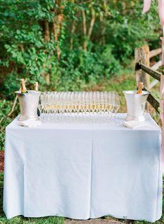 Lush Maryland Wedding with Creative New England Design Details #tentedweddingdecor #weddingflowerideas #escortcarddisplays #marylandweddingdecor #weddinggetawaycar