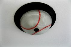 DIY Baseball light....gonna have to do this. Just use red sharpie to add the stitching. Use a bowl to make the lines the same shape.