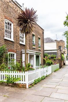 Pretty brick houses and a picket fence on a side street in Richmond, London.  #house #london #richmond