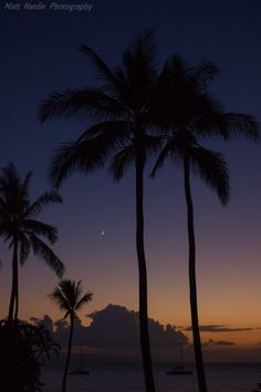 Kaanapali, Maui, Hawaii.  Amazing colors after sunset and a bright new moon. Add a couple of yachts and coconut trees and it symbolizes the Hawaiian island of Maui.  http://500px.com/photo/81446359/new-moon-kaanapali-by-matt-hardie