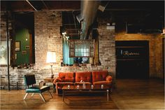 couches at the wedding reception for guests, BLAKE + NICOLE (Salvage One, Chicago) - Janelle Elise