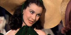 """One of our fondest memories of southern belle beauty comes from the film """"Gone with the Wind."""" Scarlett O'Hara (portrayed by Vivien Leigh) struggled with conforming to society's ideal of behaving like a lady, but the brunette actress looked beautiful as ever in her rebellious state."""