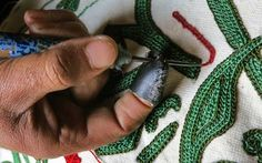 aari-kaam-Process-kashmir A thimble called 'Nyatth' is worn on the index finger of the right hand to protect it from the prick and to push the needle into the thick cloth. A single sided embroidery pattern is called 'Aksi', meaning reflection