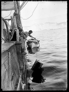 "Frank Hurley washing cinematograph film on the ""Aurora"" Format: Silver gelatin photonegative Notes: First Australasian Antarctic Expedition, Rare Photos, Old Photos, Vintage Photos, Roald Amundsen, Arctic Explorers, Heroic Age, Photos Rares, Tall Ships, Hurley"
