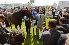 Jockey Adam Kirby and Sheikh Mohammed bin Rashid Al Maktoum celebrate French Navy's win of The Investec Diomed Stakes during Ladies Day at the Investec Derby Festival at Epsom Downs Racecourse on June 6, 2014 in Epsom, England.