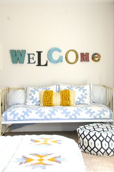 WELCOME spelled out in letters as a cute decoration for a Guest Bedroom