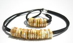 Streetwear Collection - flame worked glass discs on leather with sterling silver clasp. www.lorettidesign.com