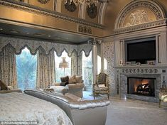 Beyonce and Jay-Z Mount their TV over the fireplace in their gorgeous Houston mansion bedroom.