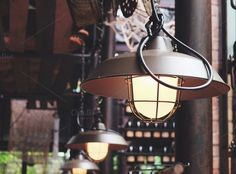 Classic hanging light bulb in cafe by Nuchylee Photo on Creative Market