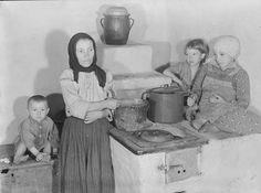 Czechoslovakia- Carpatho-Ruthenia Peasants In Home Date taken: April 4, 1938 Photographer : Margaret Bourke-White
