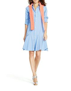 A swaying ruffled hem adds feminine flair to this menswear-inspired shirtdress. Detailed with genuine mother-of-pearl buttons, the striped style is a polished choice for the office and a chic look for dinner downtown.