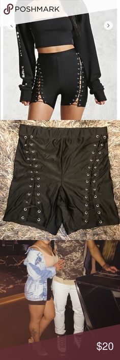Lace Up Bikers Super trendy Black lace up grommet biker shorts...made of nylon and spandex...worn once...super comfy... Shorts