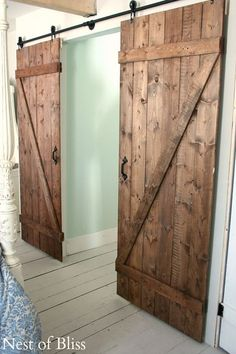 It's Friday again! Today I am sharing with you the tutorial on how we built our barn doors for our bedroom! I'll have a link for our DIY sliding door system at the end of the tutorial.   To build your