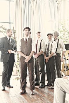 groomsmen in suspenders, best man in vest, groom in vest and jacket. love it.