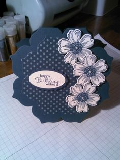 handmade card ... shaped card using largest of floral framelits ... monochromatic blue ... cute stamped and punched out flowers ... Stampin' Up!
