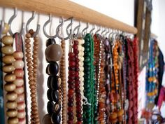 wooden dowel with cup hooks can be tailored to the space available and number/size of your necklaces and bracelets Could also use for ties & belts.