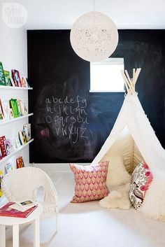 Lovely playroom with canvas teepee and fun toss cushions {PHOTO: Janis Nicolay}