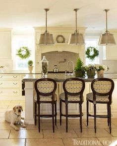 New England Home with Hushed Holiday Palette | Traditional Home...Counter stools, and pendant lights.