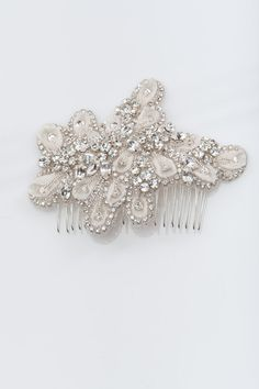 this listing is for a bridal hair comb made with high quality hand beaded rhinestone applique and a silver plated hair comb. the size of the