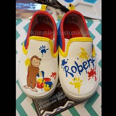 Curious george theme. I had fun painting these because I had to make it seem like curious George was painting and making a mess. #kimmiescustomkicks #handpaintedshoes #kimberlys_creations #customshoes #curiousgeorgeparty #curiousgeorgeshoes #curiousgeorge #monkey #manintheyellowhat