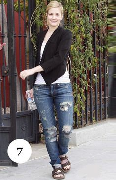 Drew Barrymore goes the Arizona with Torn Jeans. You'd think she could afford new Jeans, no?