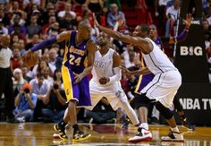 FEBRUARY 10: Kobe Bryant #24 of the Los Angeles Lakers is guarded by Dwyane Wade #3 and Chris Bosh #1