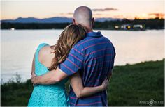 Sweet engagement photos looking at the mountain view at sunset at Sloan Lake in Denver Colorado during engagement photography session. - April O'Hare Photography http://www.apriloharephotography.com