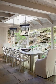 Beams were removed to allow more light to enter the room from above. Heather designed a 12-foot wooden table with a beveled zinc top to fit the narrow room. #homedecor #southernliving #diningrooms