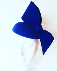 Blue felt hat with large bow. Small hat perfect for a wedding guest or day at the races.