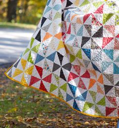 Pinwheel quilt. One solid, one print, plus white, for each pinwheel. I wonder if this was made from nickels or fat quarters.